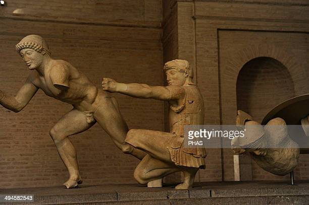 East Pediment's Group of the Temple of Aegina Ca 490 BC First battle of Greeks and Trojans Helper kneeling archer Herakles and a injured warrior...