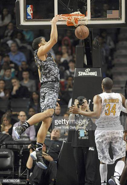 East player Jahill Okafor dunks Injured Isaiah Whitehead of Lincoln HS during game action of the 2014 Jordan Brand Classic All American game at the...