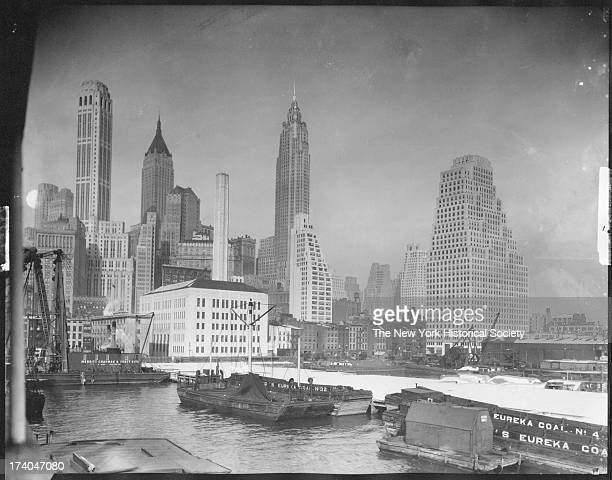 East River and South Street, with skyscrapers, New York, New York, 1932.