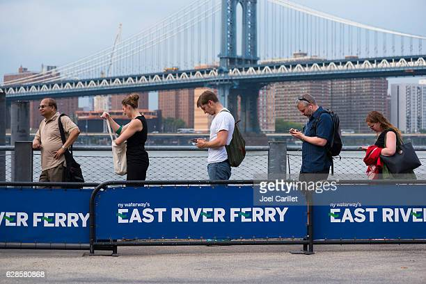 east river ferry stop in brooklyn, new york city - new yorker building stock photos and pictures