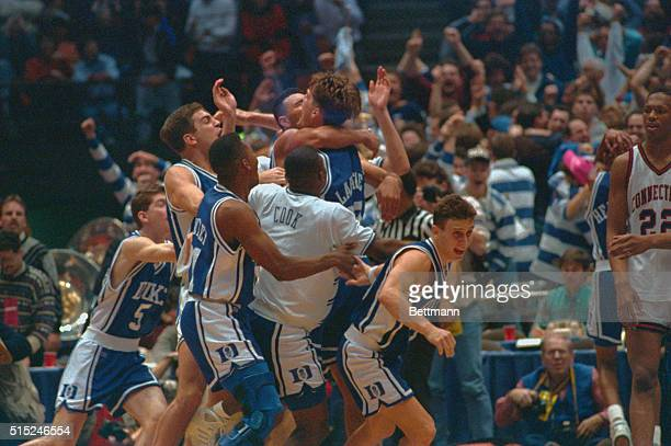 East Rutherford, New Jersey: Duke University teammates jump all over Christian Laettner who hit the winning basket in overtime to defeat the...