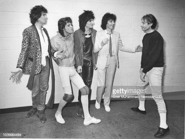 Members of the Rolling Stones pose for photographers at the Brendan Byrne Arena in the Meadowlands NJ before their concert on November 5 1981