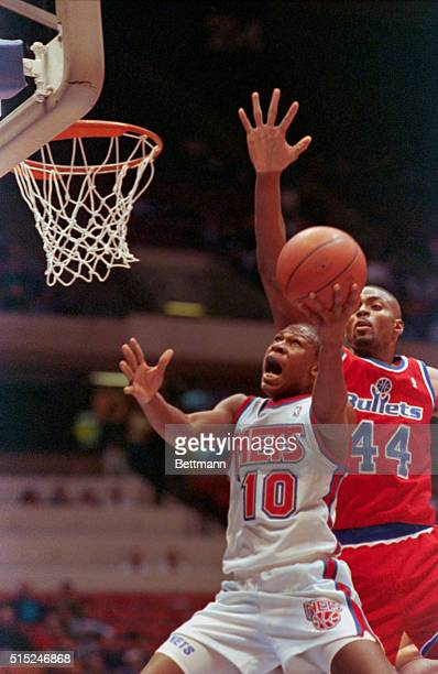 Mookie Blaylock of the New Jersey Nets drives the lane for two but is fouled Harvey Grant of the Washington Bullets late in the fourth quarter at...