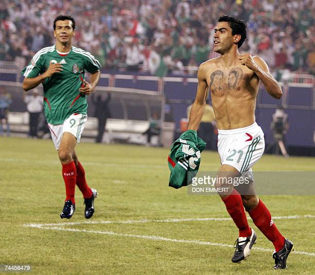 Nery Castillo of Mexico takes his shirt of in celebration after scoring in the first round CONCACAF Gold Cup match against Cuba 08 June 2007 at...