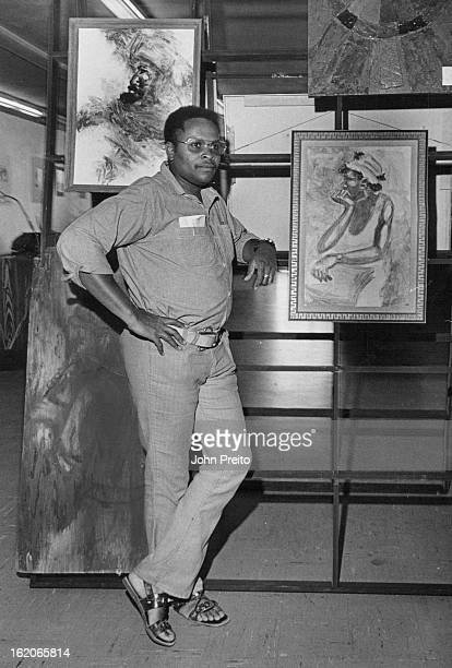 JUN 2 1970 JUL 20 1970 East Side Art Show Artists Bob Ragland examines paintings part of art show at East Side Action Center 2300 Welton St The show...