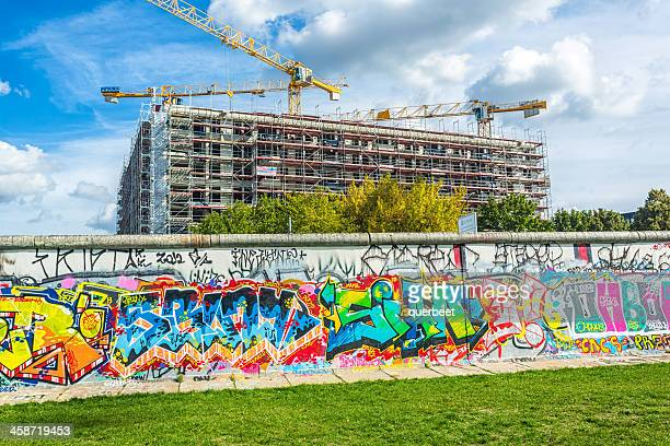 east side gallery wall in berlin with construction site - berlin wall construction stock pictures, royalty-free photos & images