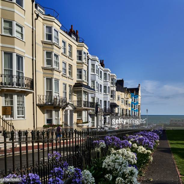 """East Sussex. South coast of England. City of Brighton and Hove. Tay sculpture by Romany Mark Bruce 2009. """"A row of what once were individual town..."""