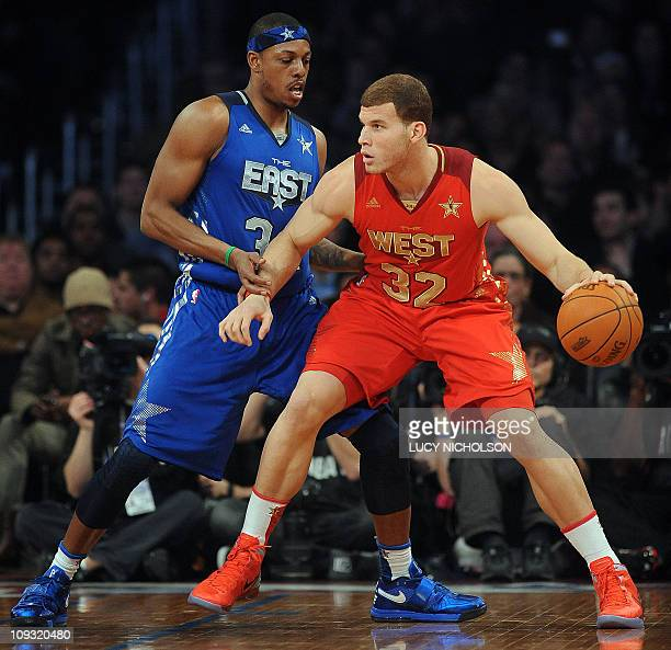 East Team's Dwyane Wade of the Miami Heat guards West Team's Blake Griffin of the LA Clippers during the NBA AllStar Game on February 20 part of NBA...