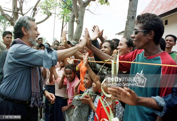 East Timor President Xanana Gusmao is greeted by refugees at the Atambua border town West Timor 04 November 2002 Gusmao promised to guarantee the...