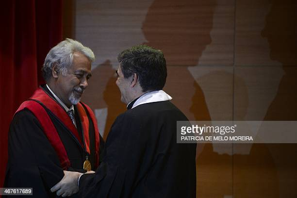 East Timor Prime Minister Kay Rala Xanana Gusmao receives the Honoris Causa degree by the hand of the Rector Antonio Cruz Serra during a ceremony at...