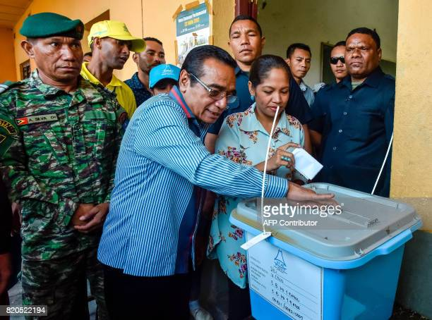 East Timorese President Francisco Guterres and first lady Cidalia Mozinho vote during parliamentary election in Dili on July 22 2017 East Timor...