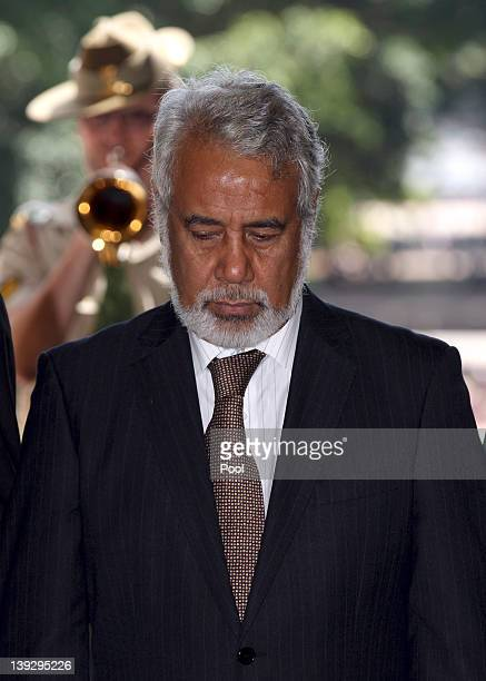 East Timorese Prime Minister Xanana Gusmao bows his head as the last post is played during a visit to the Anzac War Memorial on February 19 2012 in...