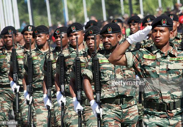 East Timorese soldiers march during a ceremony to mark country's Independence Day in Dili on May 20 2008 East Timorese leaders gathered under tight...