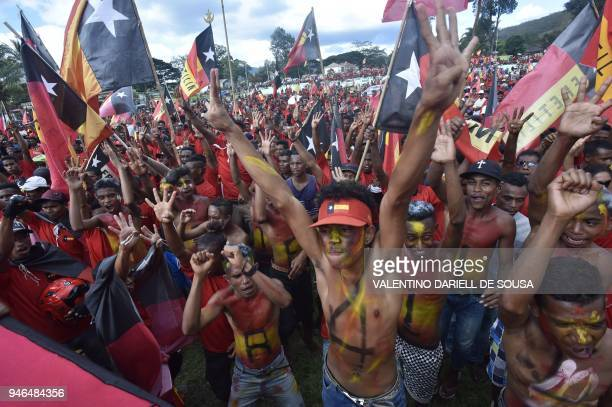 TOPSHOT East Timorese supporters of the Fretilin party participate in a political rally in Aileu on April 15 2018 East Timor is holding its new...