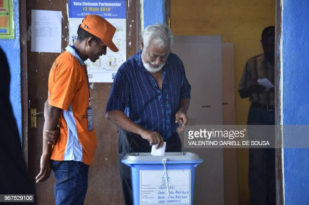 East Timor's former president and independence hero Xanana Gusmao casts his ballot during the general election in Dili on May 12 2018 East Timor...