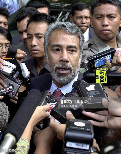 East Timor's independence hero President elected Xanana Gusmao is surrounded by journalists and photographers after meeting Indonesian President...