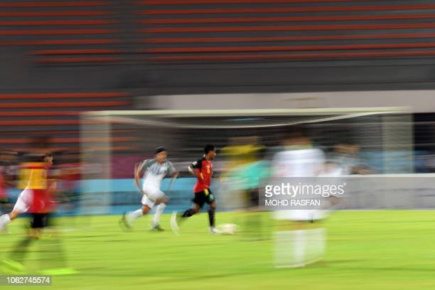 East Timor's midfielder Nataniel De Jesus Reis runs with the ball during the AFF Suzuki Cup 2018 football match between East Timor and the...