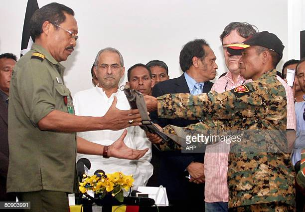 East Timor's President Jose RamosHorta looks on as rebel leader Gastao Salsinha who topped the list of those most wanted over an attack on the...