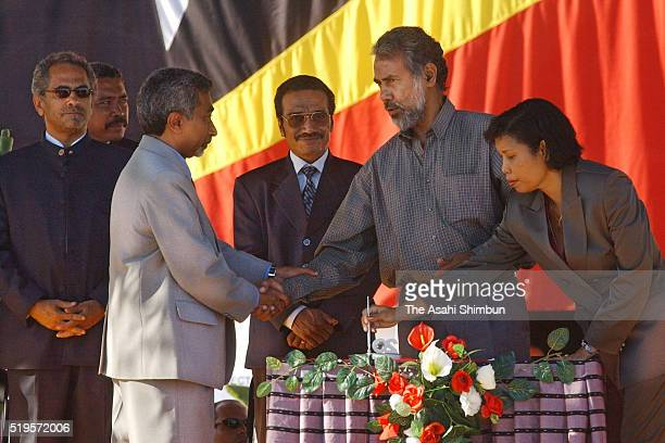 East Timor's President Xanana Gusmao poses with senior cabinet members after being sworn in during the independence ceremony on May 20 2002 in Dili...