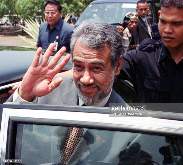 East Timor's President Xanana Gusmao waves his hand as he arrives at Kupang airport West Timor 01 November 2002 Xanana Gusmao arrived in Indonesia...