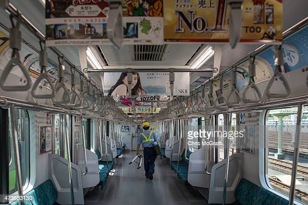 East Tokyo Media Services employee replaces advertisements inside a Yamanote Line train carriage at the JR East General Rolling Stock Center on May...