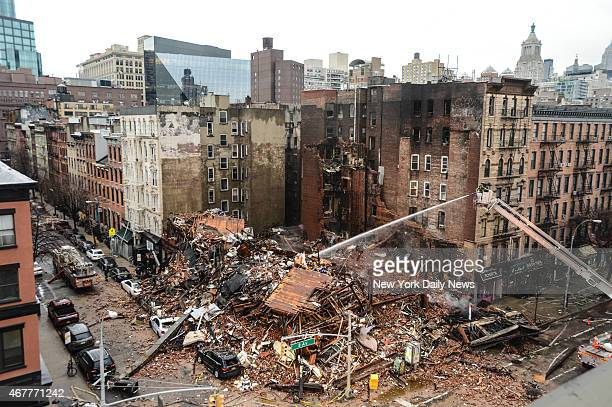 East Village gas explosion causes inferno destroys 4 buildings 25 injured 2 people missing Con Ed faulted gas pipe work shortly before blast