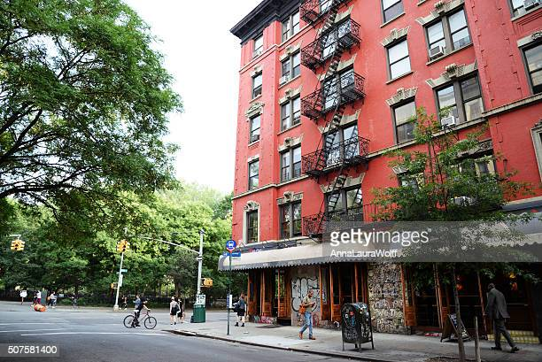 New York, United States - August 11, 2015: Red building exterior in East Village, nice neighborhood in New York with a lot of bars and restaurants.