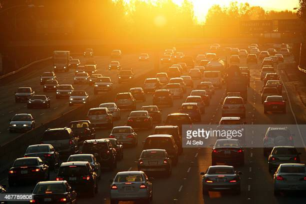 Eastbound 101 freeway traffic drives into the sunrise near White Oak Avenue in the San Fernando Valley as it's expected to be another hot day with...
