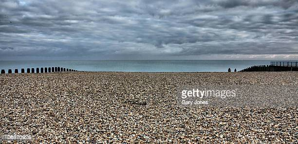 eastbourne beach - pebble stock photos and pictures