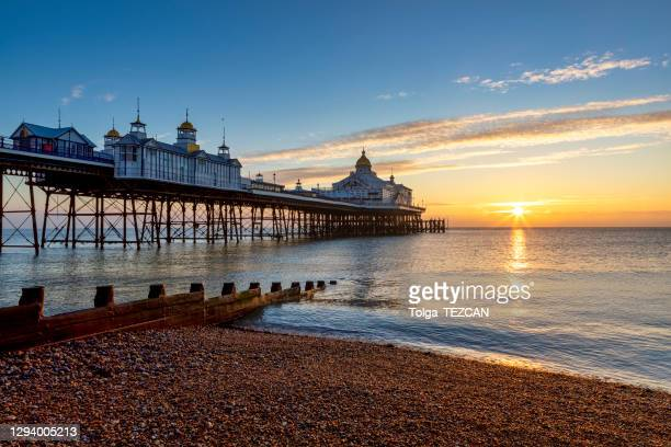 eastbourne pier at sunrise. - eastbourne stock pictures, royalty-free photos & images