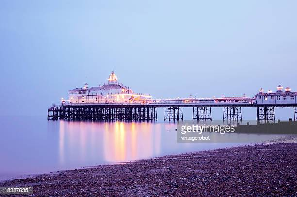 eastbourne pier at sunset - eastbourne stock pictures, royalty-free photos & images