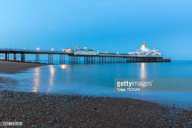 eastbourne pier - pebble stock pictures, royalty-free photos & images