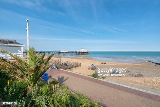 eastbourne promenade, beach and eastbourne pier - eastbourne stock pictures, royalty-free photos & images