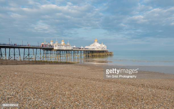 eastbourne seafront and eastbourne pier - eastbourne stock pictures, royalty-free photos & images