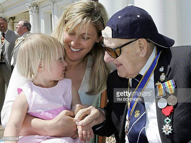 Britain's oldest man Henry Allingham who is 110 today meets his great granddaughter Ami Gray Carlson from Minnesota USA with her daughter Lauren who...
