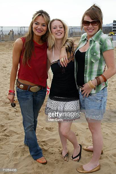 EastEnders actresses Kara Tointon Kelly Shirley and Shana Swash pose backstage at T4 On The Beach on June 18 2006 in WestonSuperMare England