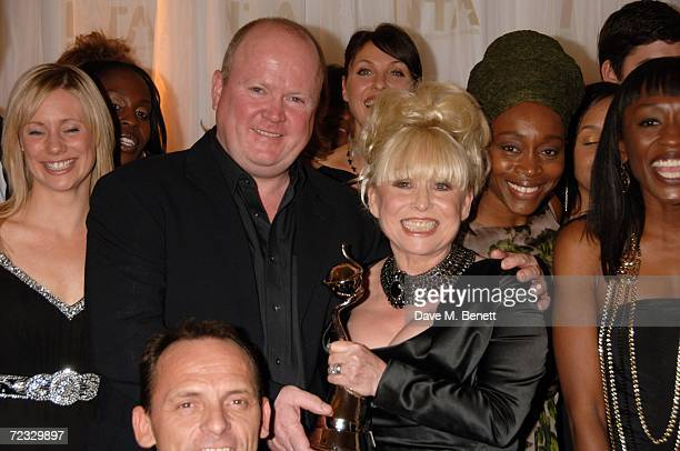 Eastenders cast members including Steve McFadden and Barbara Windsor pose in the Awards Room with the Most Popular Serial Drama Award for Eastenders...