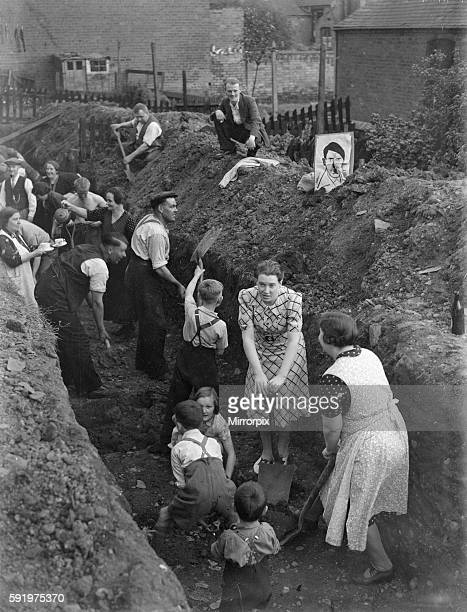 Eastenders seen here digging a trench for a communal air raid shelter in their back gardens in East London on the day Hitler and Nazi Germany invade...