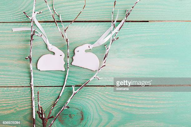 Easter background . Top view of two porcelain bunnies with copy space
