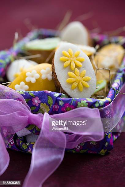 Easter basket with mini cakes decorated with marzipan