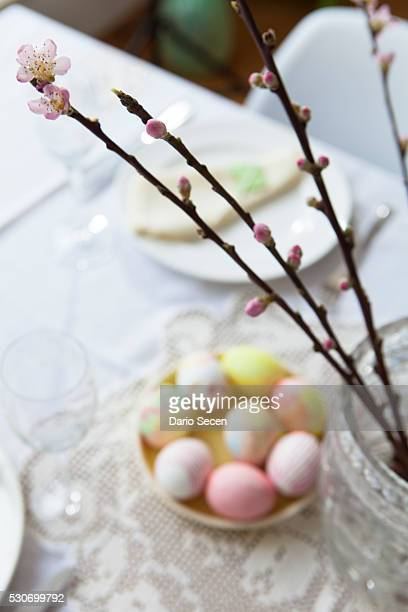 Easter breakfast, set table with painted eggs and cherry blossom, Munich, Bavaria, Germany