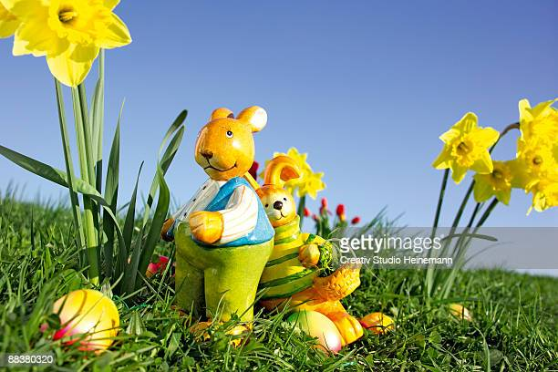 Easter bunny and Easter eggs on grass, close-up