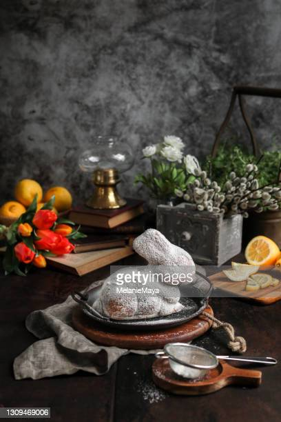 easter bunny cake with tulips in dark rustic kitchen - easter sunday stock pictures, royalty-free photos & images
