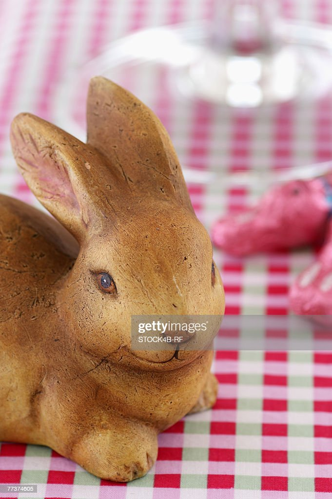 Easter bunny made of ceramic on a table, close-up : Photo