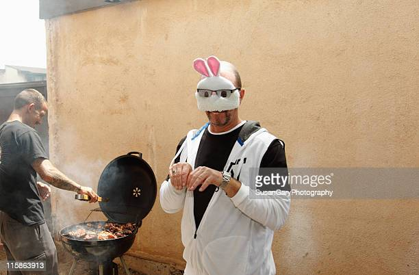 easter bunny man at family barbeque - easter bunny man stock pictures, royalty-free photos & images