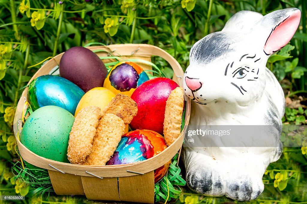 Easter colored eggs with biscuits and bunny : Stock Photo