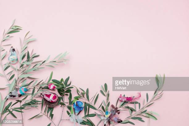 easter composition with olive branch and easter decoration on pastel pink background - easter sunday stock pictures, royalty-free photos & images