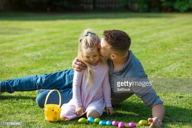 easter day with my daddy! - easter egg hunt stock pictures, royalty-free photos & images