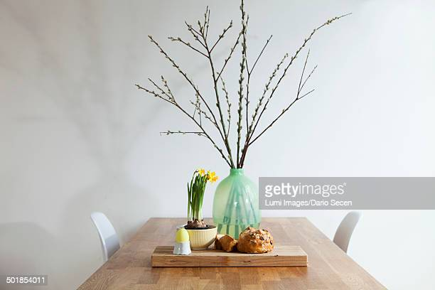 Easter decoration, bread, painted egg, daffodils and willow twigs, Munich, Bavaria, Germany