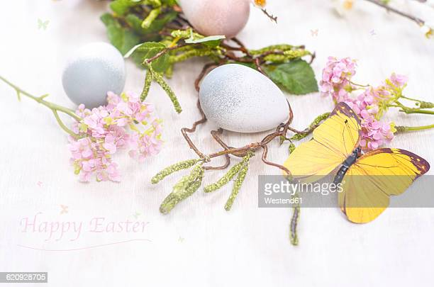 easter decoration with eggs and blossoms - happy easter text stock pictures, royalty-free photos & images